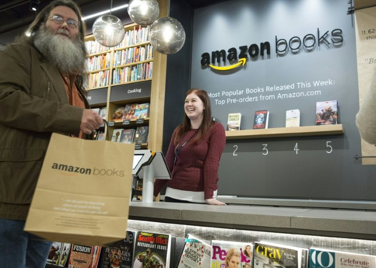 Customers shop at the new Amazon Books store at University Village in Seattle, Washington on November 3, 2015